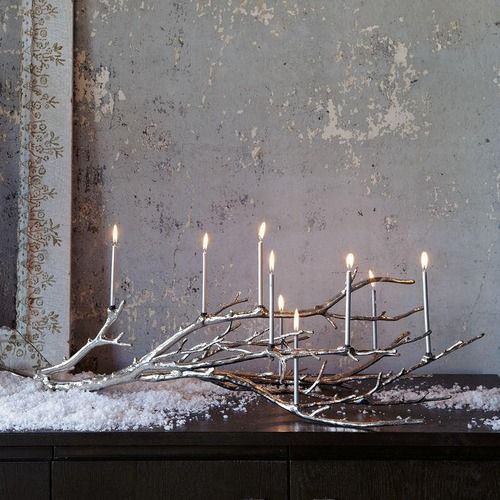 candles snow and branch
